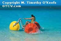 Turks & Caicos Couple on Water Bike copyright M. Timothy O'Keefe - www.GuideToCaribbeanVacations.com